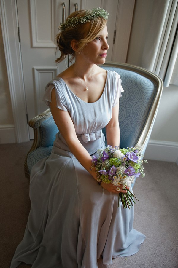 A Pale Blue and Pretty Belle & Bunty Wedding Dress And Flowers In Her Hair…