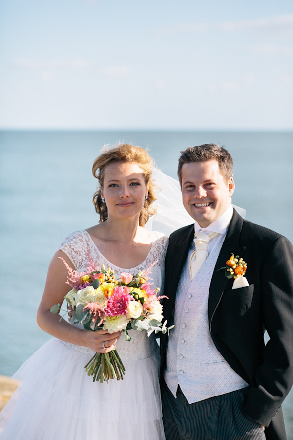 An Elizabeth Avey Tiered Wedding Dress and Kate Spade Glitter Heels For A Relaxed And Elegant Seaside Meets Countryside Wedding