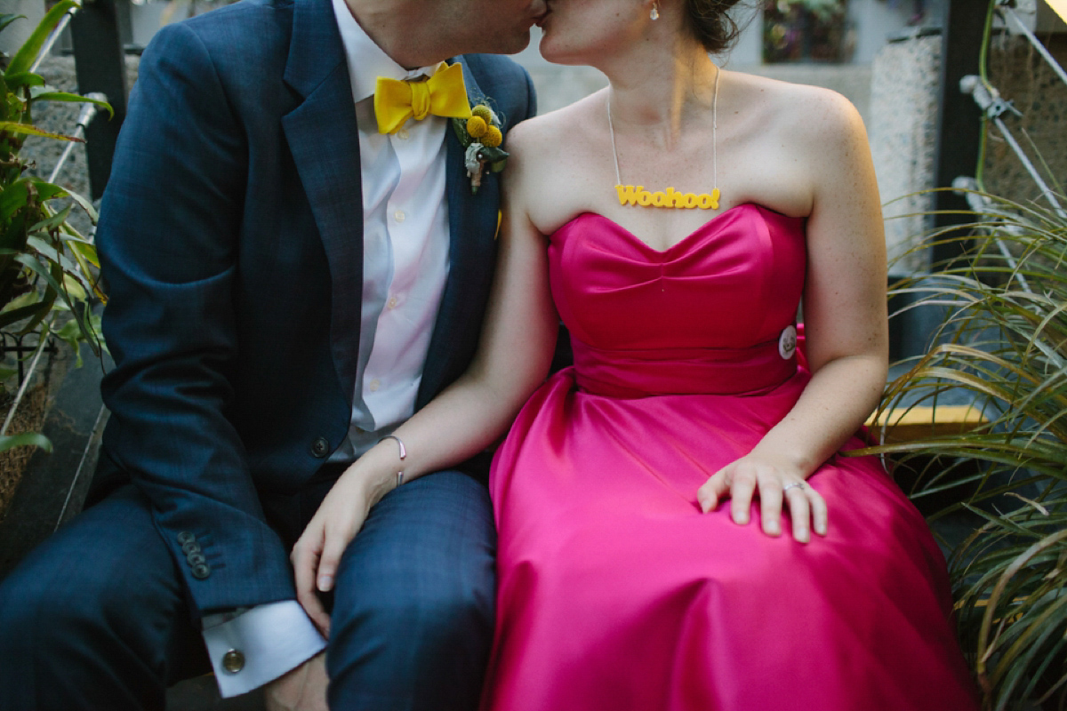 A pink Candy Anthony dress for a colourful and modern wedding at The Barbican. Photography by Joanna Brown.