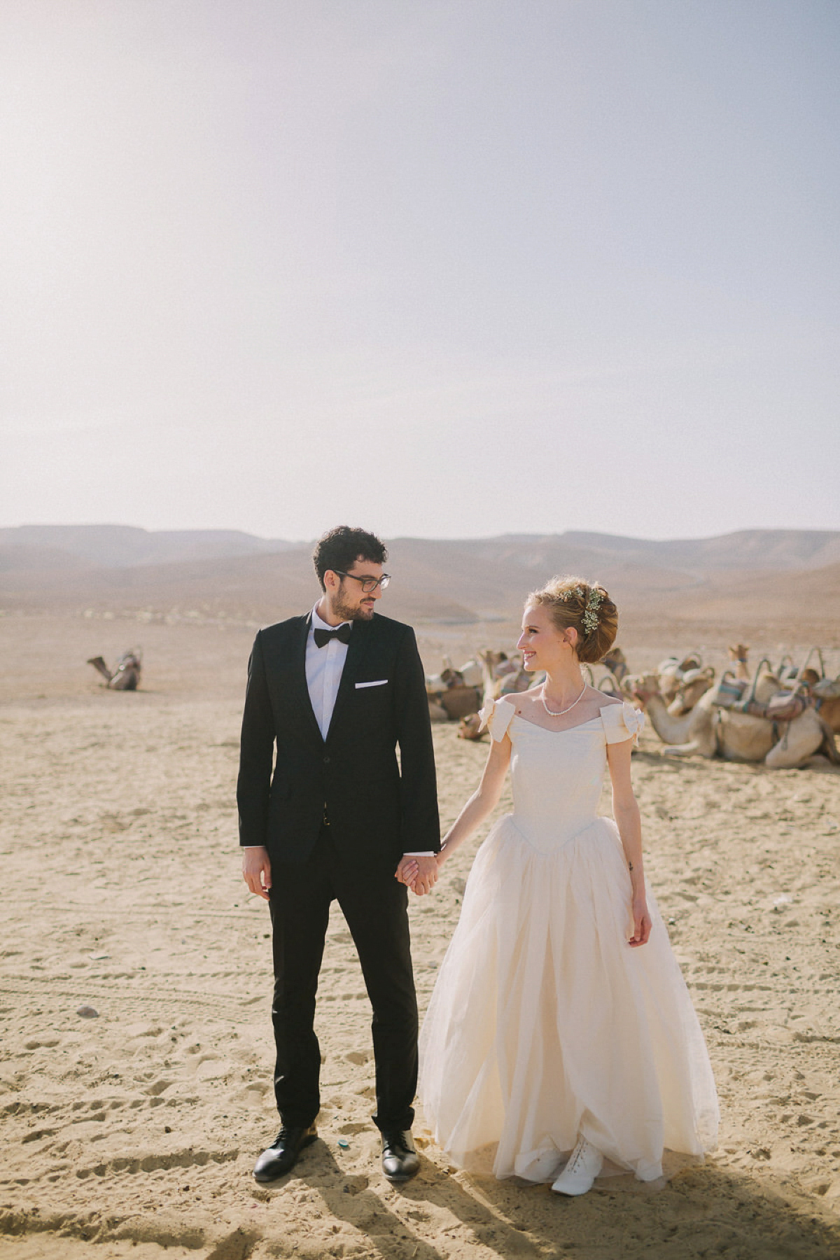A Vintage Dress and and Laceup Boots for a Jewish Ceremony and Modern Festival Wedding in the Desert