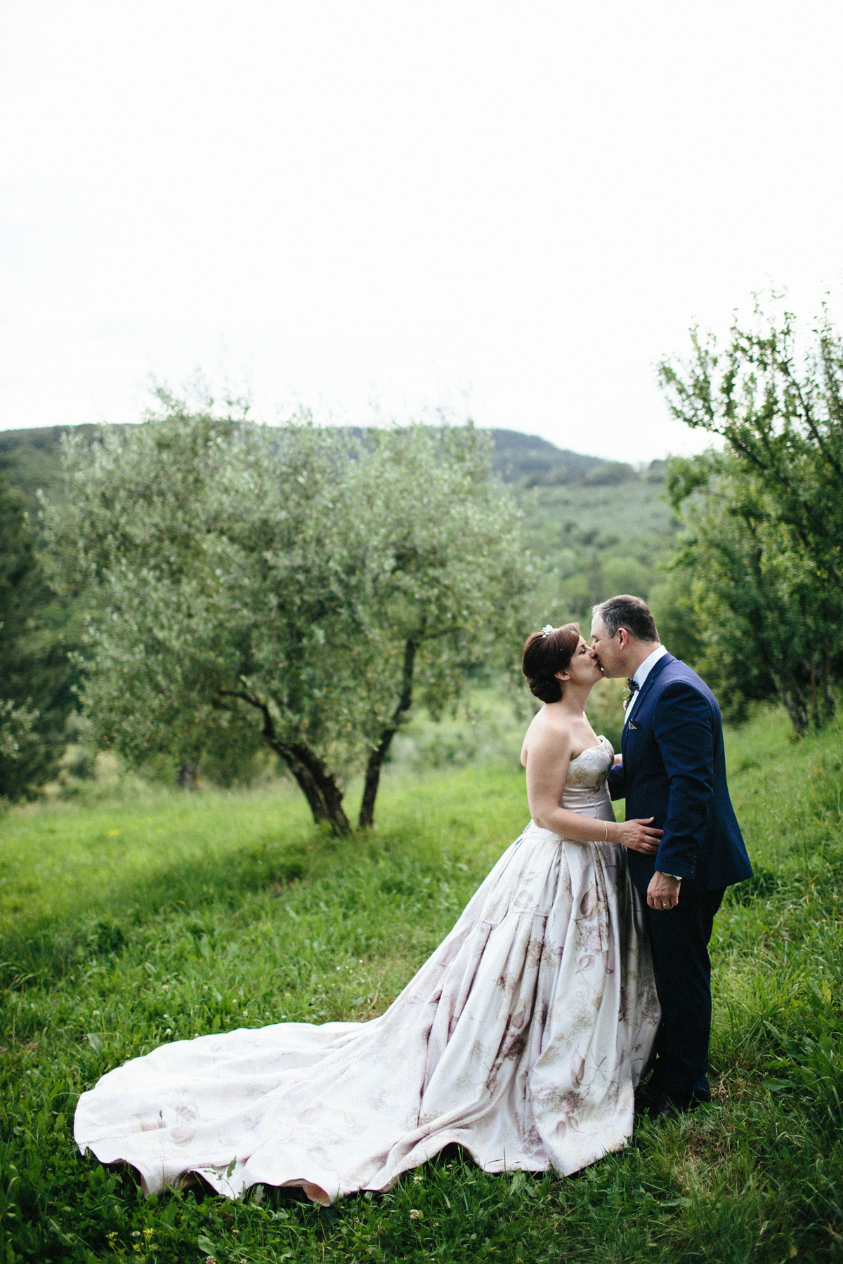 Bride Lucy wore a gold floral Vera Wang gown for her romantic outdoor wedding in the Italian countryside. Images captured by Claudia Rose Carter.