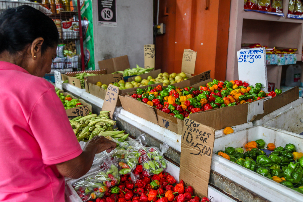 port of spain fruit vendor hot peppers