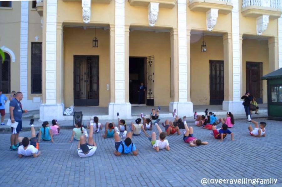 PE classes in Plaza Vieja, Havana