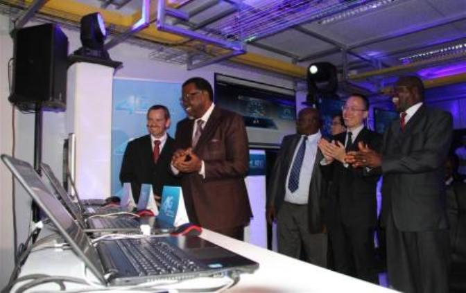 Namibian President Hage Geingob (2nd L) applauds after MTC 4.5G speed test in capital Windhoek