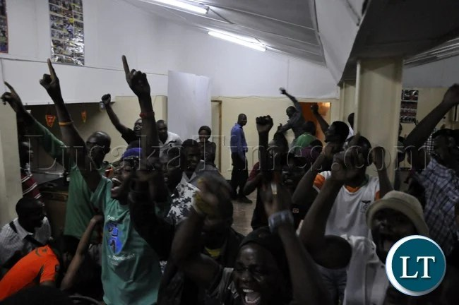 Soccer fans cheering the Chipolopolo team during the match against Bukina Faso.