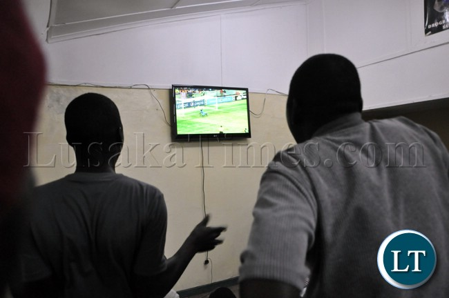 Soccer fans following the Zambia versus Bukina Faso match during the live broadcast in Lusaka