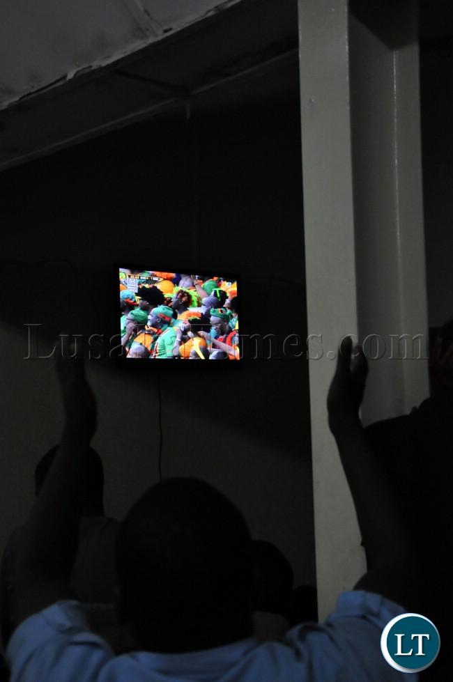 Soccer fans watching proceedings of the Zambia Bukina Faso match