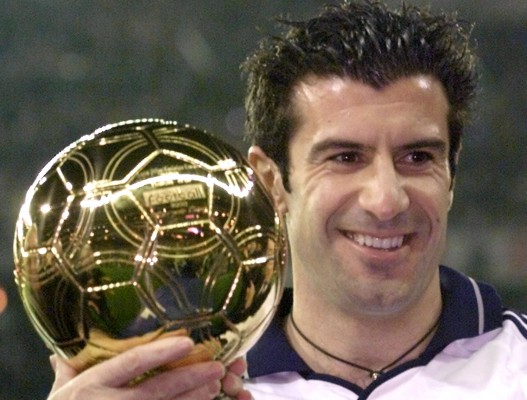"""Real Madrid's Portuguese star Luis Figo poses for photographers as he holds the """"Golden Ball"""" trophy.."""