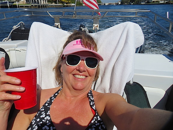 Karen relaxing in the sun on the ICW cruising home from Delray.