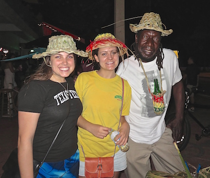 A local hat maker poses with the ladies.