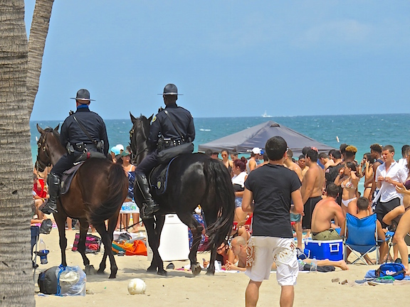 Cops on horses are popular and imposing on the beach. They had very few kids to wrangle on a blustery Spring Break Saturday.