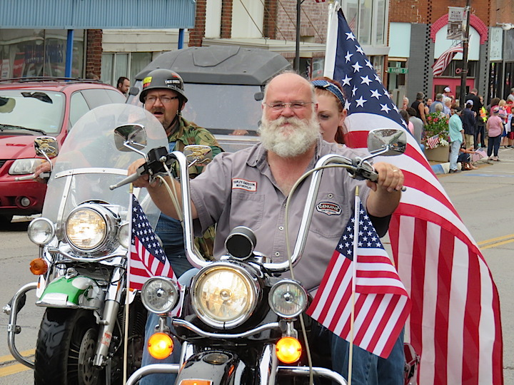 Local Harley enthusiasts kicked off the procession with flags flying and thundering exhaust echoing off the historic buildings lining the route.