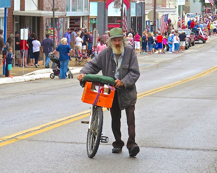 This lone, homeless hillbilly proudly marched his bicycle in the middle of the cavalcade with aplomb.