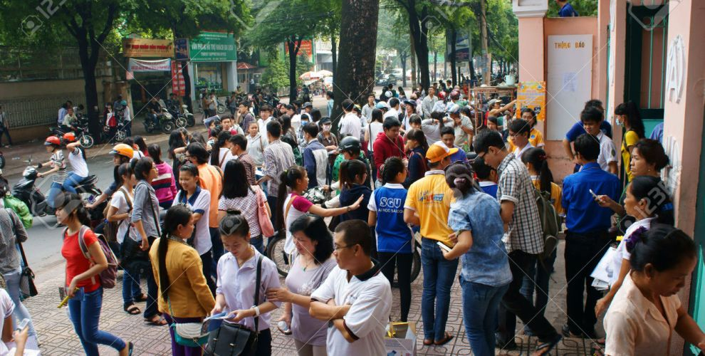 HO CHI MINH CITY, VIETNAM- JULY 5: Pupil finish exam time in examination season to select university for future, crowd of examinee leave school, Vietnam, July 5, 2014