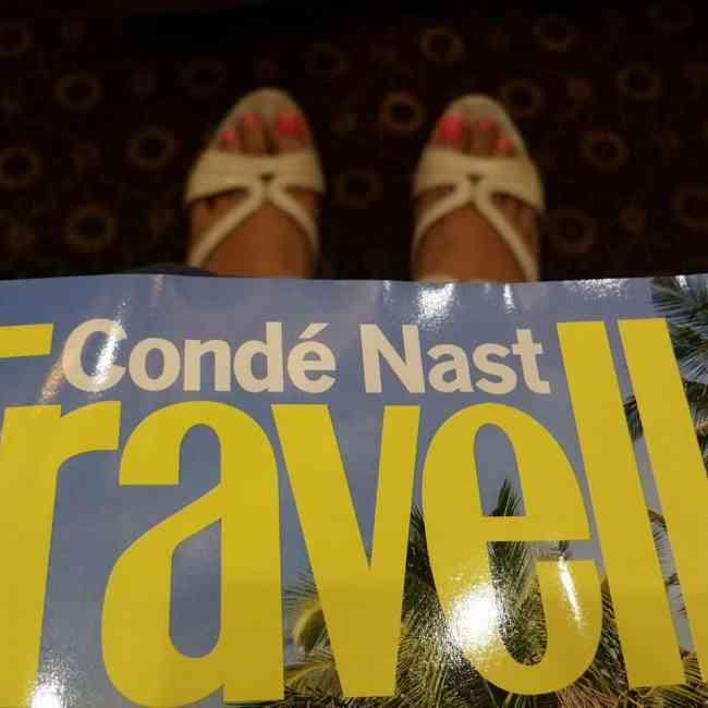 Travel magazine and heels