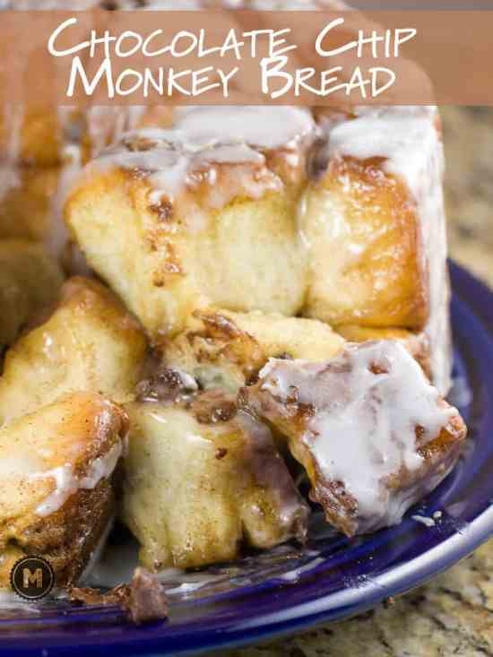 Chocolate Chip Monkey Bread - Pull-apart dough balls baked in cinnamon sugar and filled with chocolate. Who doesn't love monkey bread?!