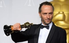 "Emmanuel Lubezki poses in the press room with the award for best cinematographer of the year for ""Gravity"" during the Oscars at the Dolby Theatre on Sunday, March 2, 2014, in Los Angeles.  (Photo by Jordan Strauss/Invision/AP)"