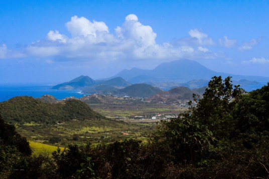 Off in the distance is Nevis Peak on the island of...wait for it...Nevis. Part of St. Kitts.
