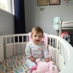Natalie & her extremely adorable crib sheets.