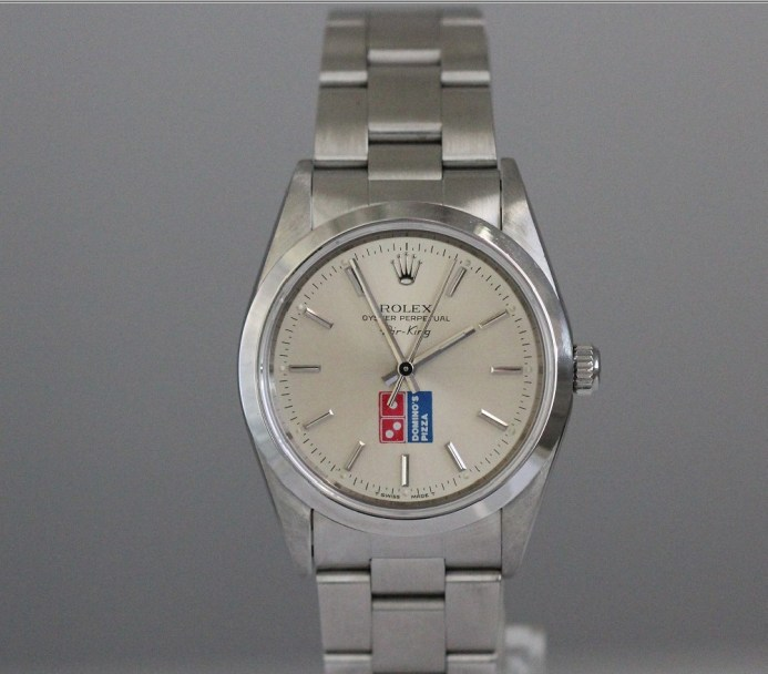 Rolex AK Dominos Pizza Logo droit