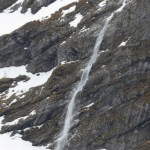 This is a snow fall, not a water fall. As the snow melts it gets loose and cascades down the mountain