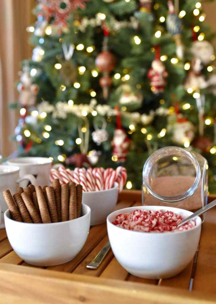 Hot cocoa bar at a rustic Christmas tree trimming party