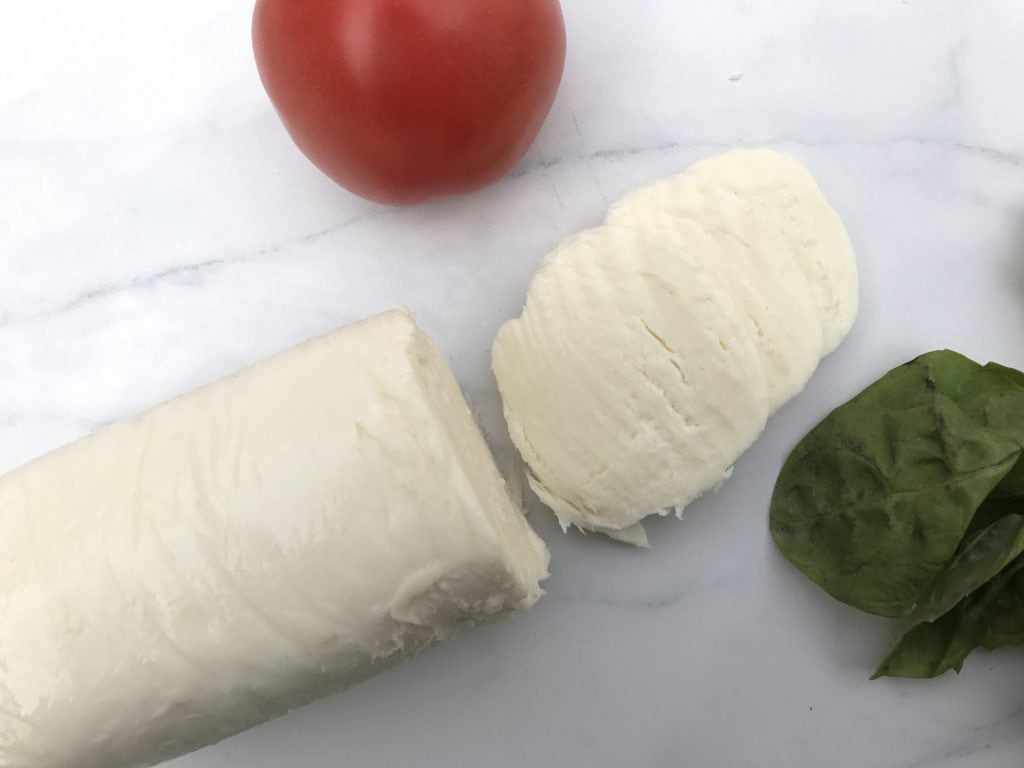 Caprese appetizers with sliced tomatoes