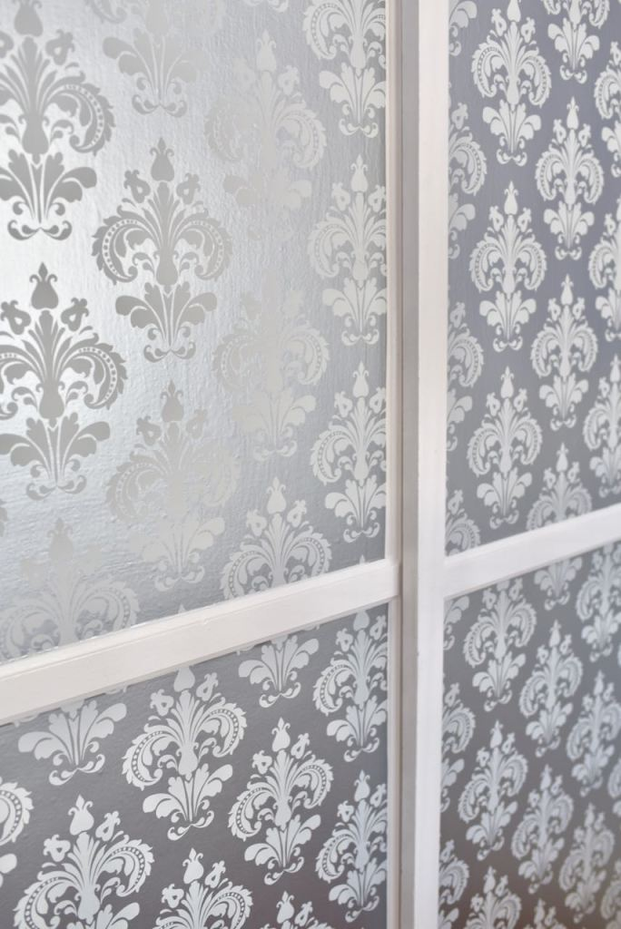 Closet makeover with wallpaper on closet doors