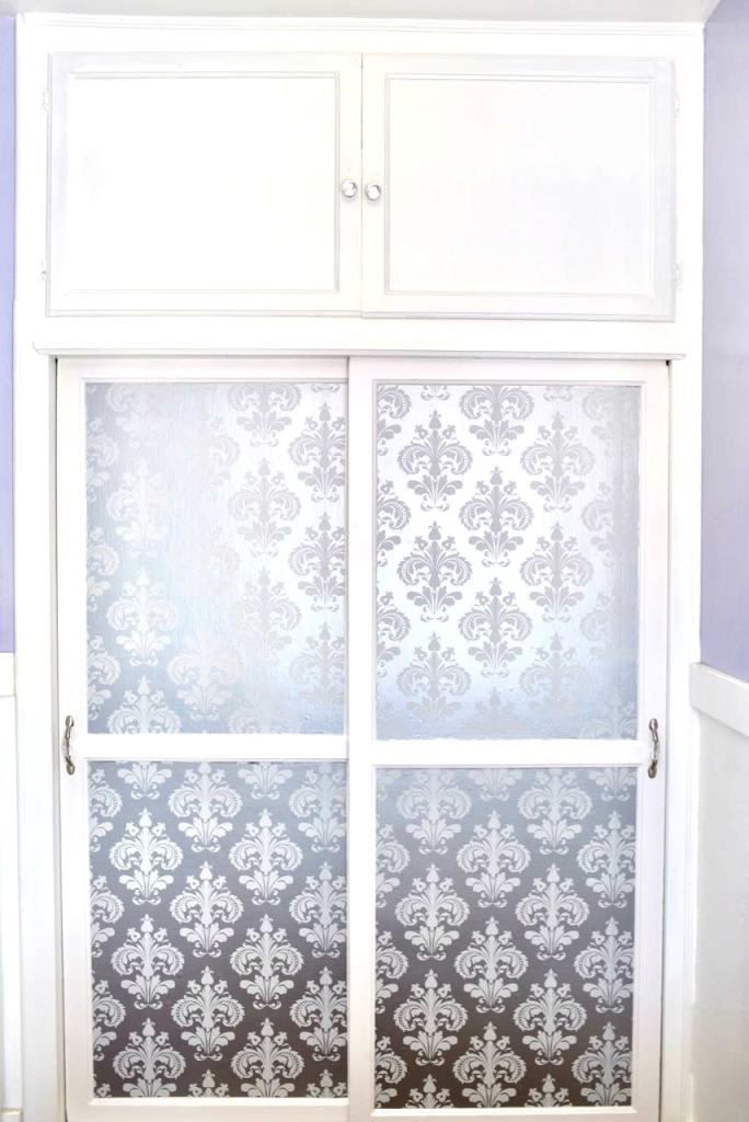Girls closet makeover with wallpaper on closet doors