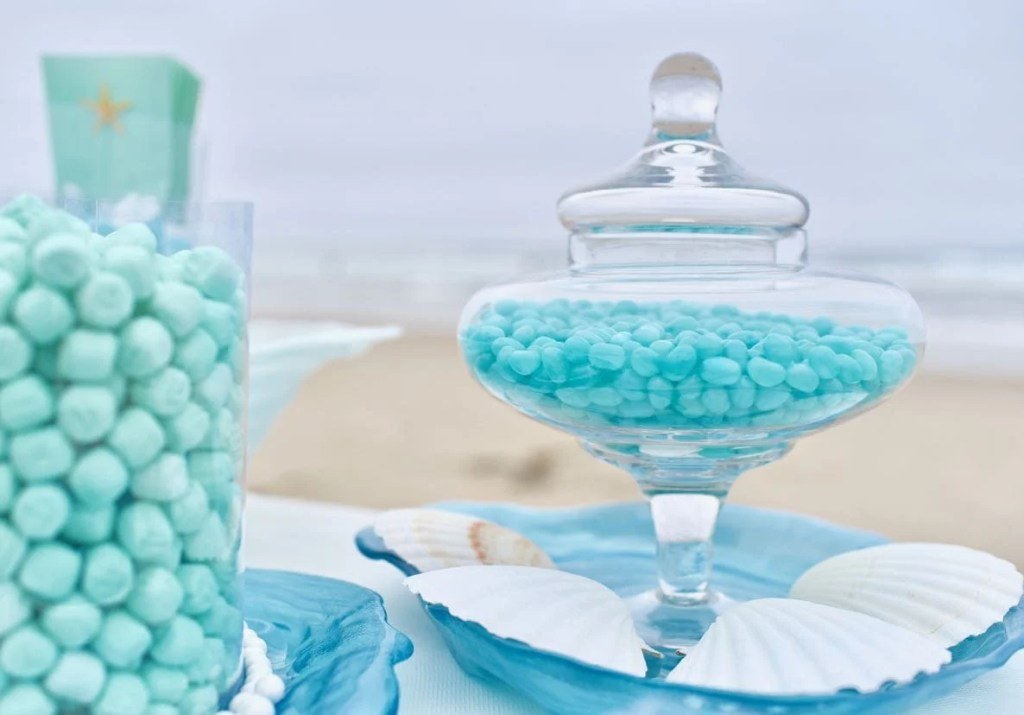 Blue candy buffet at beach wedding with ocean theme