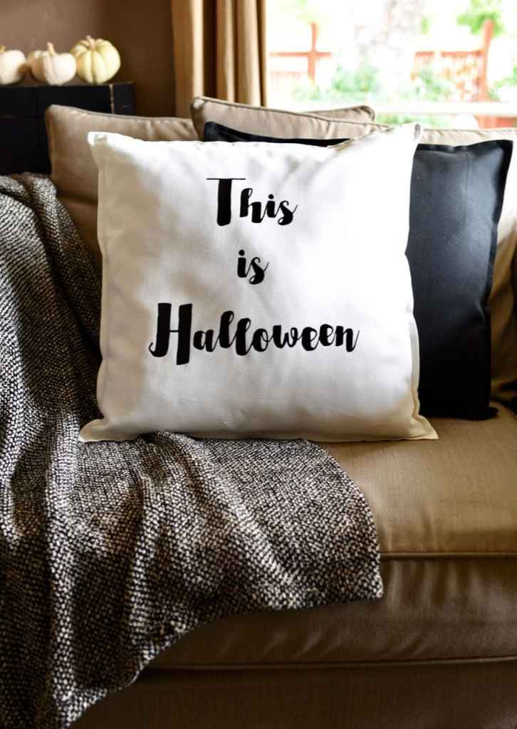 DIY Halloween pillow with Cricut Explore Air 2 and black iron-on.  So easy and cute!