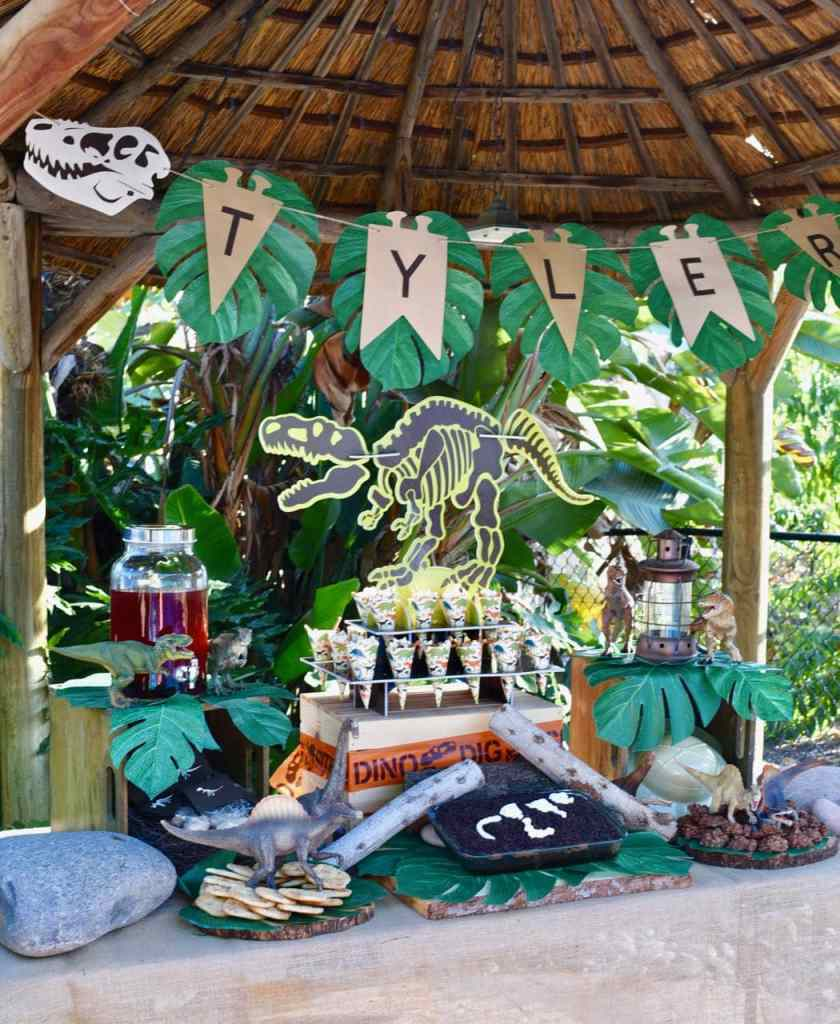 Dinosaur party with dinosaur cookies, dinosaur cake, lots of dinosaur decorations, and more!