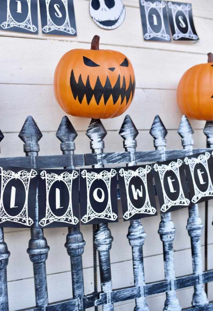Nightmare Before Christmas pumpkins on cemeterty gate at Nightmare Before Christmas party