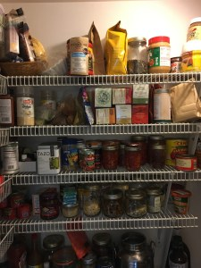 messy front view of pantry