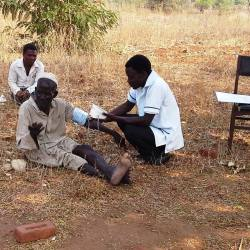 Peter works with local villagers to provide health assessments and guidance.