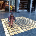 Dancing on the Lighted Floor At the Mall – WW