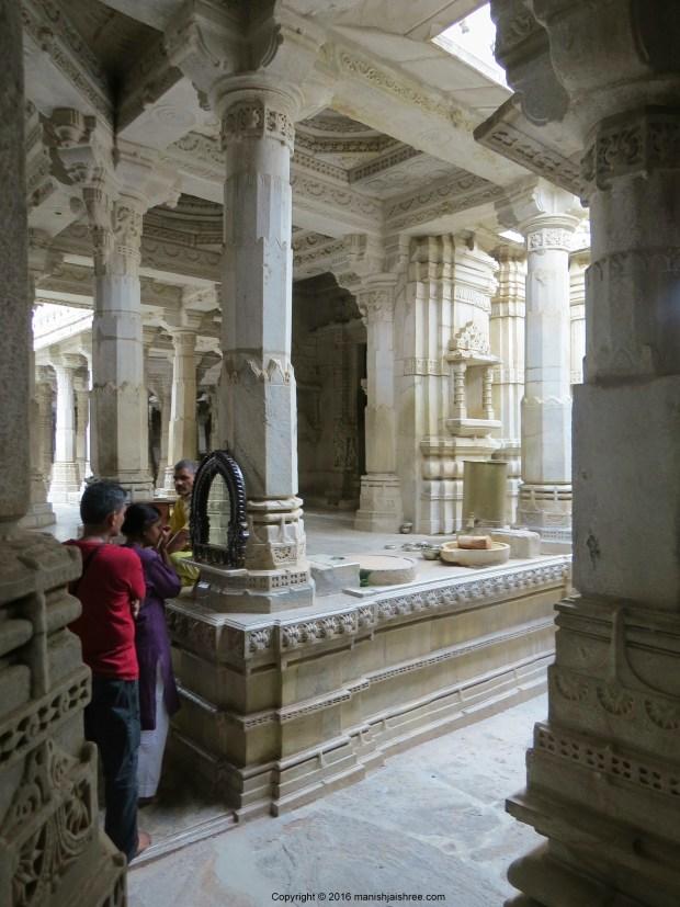 In Ranakpur Jain Temple, putting the Chandan Tika