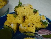 Khaman dhokla  is a savory steamed cake made from gram flour. khaman is soft and fluffy, mildly tangy-sweet and a great snack anytime of the day. this is also an instant...
