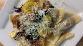 Storico Fresco Alimentari Fresh Raviolis topped with CSA squash, carmelized onions and Grana Padano