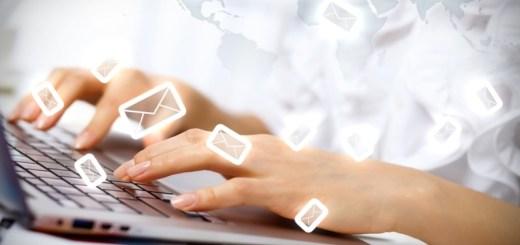 girl typing on laptop envelop symbols