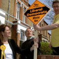 Winning elections: Lynne Featherstone and David Winskill put up a poster