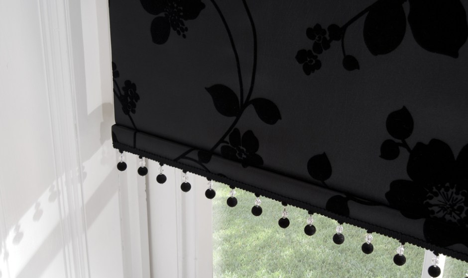 Black patterned roller blinds with decorative trim
