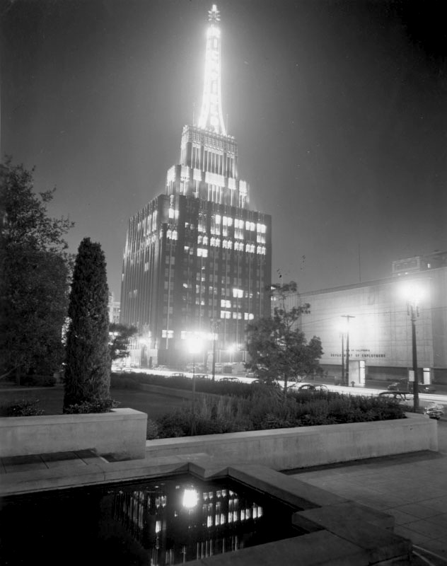 The Richfield Tower as seen from the Flower Street reflecting pool of the Los Angeles Central Library, 1950s