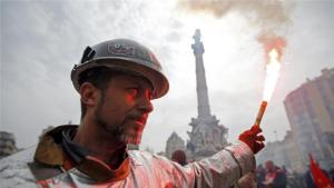 A worker demonstrates against the French labour law proposal in Marseille