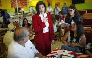 In this May 31, 2016 file photo, Nevada Democratic Senate candidate Catherine Cortez Masto, center, speaks to supporters during an event at a restaurant in Las Vegas. (AP Photo/John Locher, File)