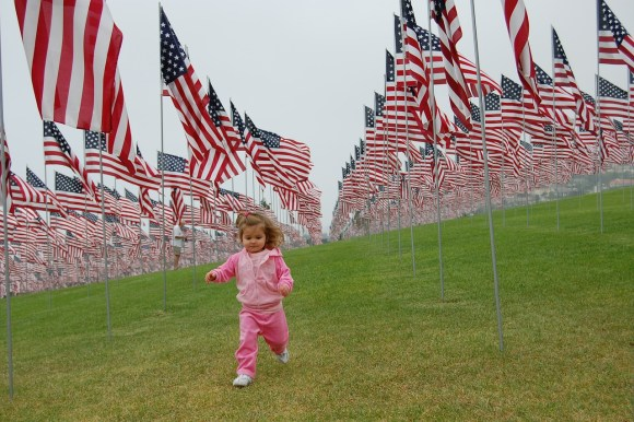 toddler and flags