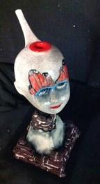 doll head butterfly eyes
