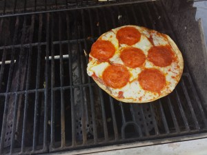 small pizza on grill