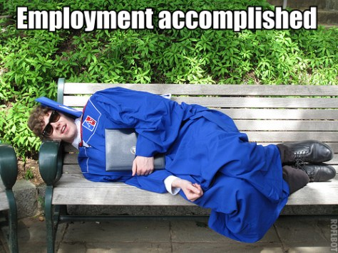 Recent graduate Matthew Hurst sleeps on a campus bench of American University, in full cap-and-gown regalia