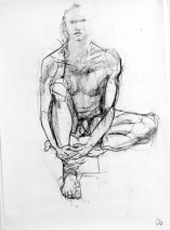 A charcoal life drawing of male model Andres, sitting face on, one leg folded under him, both hands holding his other leg